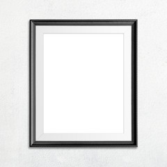 Black picture frame on white wall.
