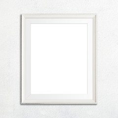 White picture frame on white wall.