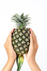 Green pineapple hold by hand isolated on white background