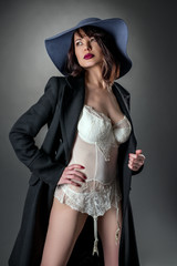 Studio portrait of glamorous woman dressed sexy