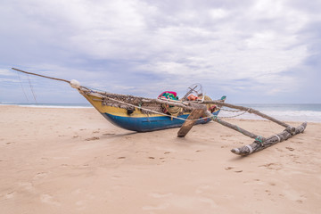 Wooden fishing boat at the sealandscape.