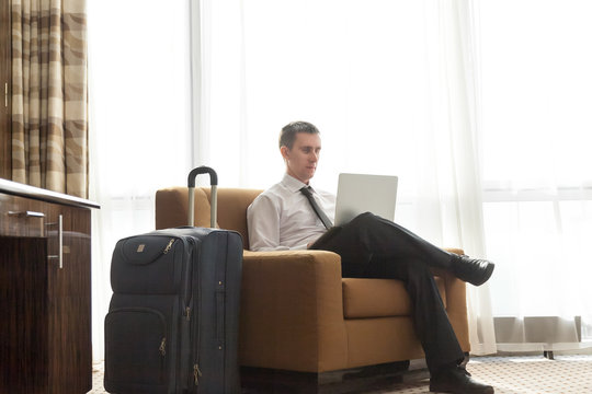 Young businessman working in the hotel room