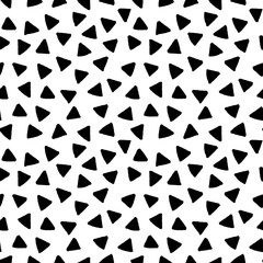 Black and white triangles hand drawn simple geometric seamless pattern, vector