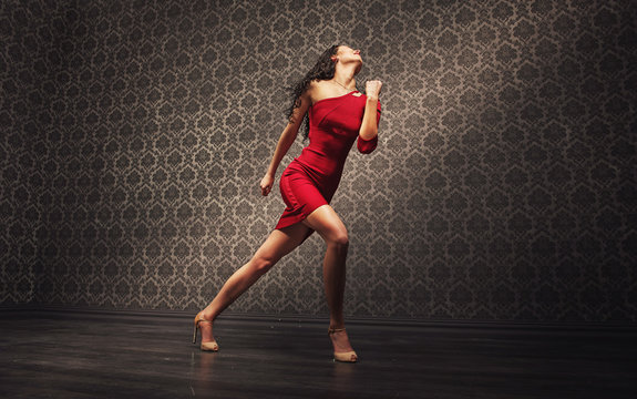 Young latin dancer practicing alone