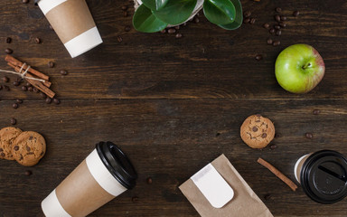 Top view wooden table with coffee, apple, cookies