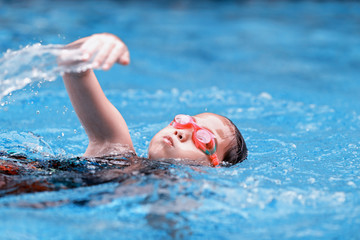 children girl in swimming pool