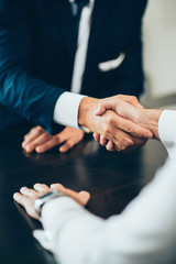 Handshake confirming business deal