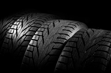 Car tires isolated on black background