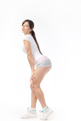 Young woman doing squatting exercise isolated on white background