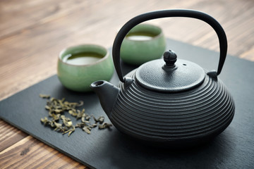 Green tea in cast-iron teapot