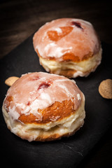 Donut with icing and rose jam.