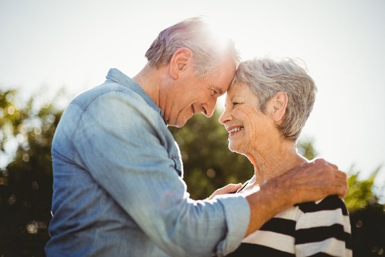 Side view of romantic senior couple looking at each other