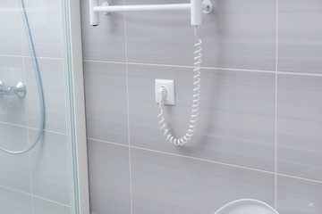Shower wall with towel warming rack cord