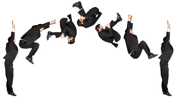 businessman somersault isolated on white