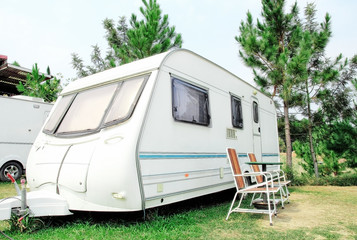 Travel Trailer with chair in the nature