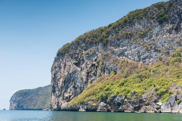 Mountain island on the sea blue sky