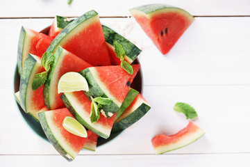 Watermelon. Slices of fresh watermelon on white