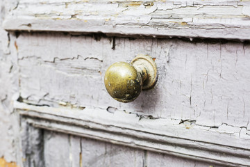 Door handle on an antique wooden door