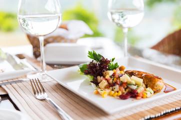 Fototapeta close up of food and water glasses at restaurant obraz
