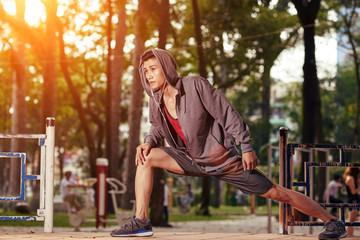 Asian sportsman doing exercise for his legs