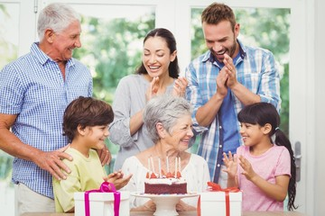 Happy family with grandparents during birthday party