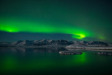 Spectacular auroral display over the ice lagoon Jokulsarlon, Iceland