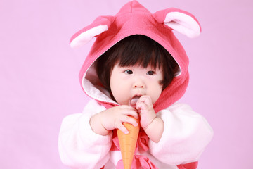baby dressed in Easter bunny ears with carrot