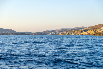 Sailing off from Syros port. Deep blue sea in the foreground.