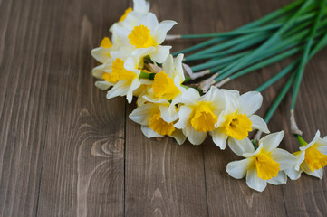 narcissus flowers on a wooden table