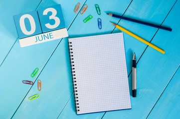 June 3rd. Image of june 3 wooden color calendar on blue background.  Summer day, empty space for text