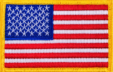 Close up of a USA Flag patch with yellow trim