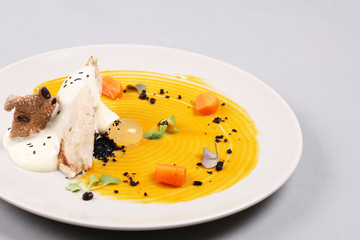 chicken breast with vegetables on a white plate.