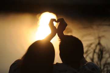 Young couple on a sunset.