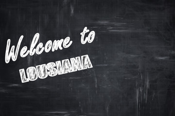 Chalkboard background with chalk letters: Welcome to lousiana