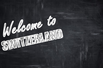 Chalkboard background with chalk letters: Welcome to switzerland
