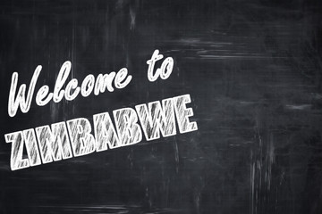 Chalkboard background with chalk letters: Welcome to zimbabwe