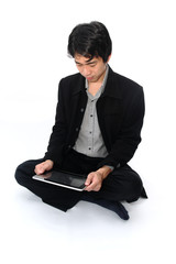Businessman relax sitting with a digital tablet