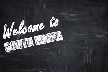 Chalkboard background with chalk letters: Welcome to south korea
