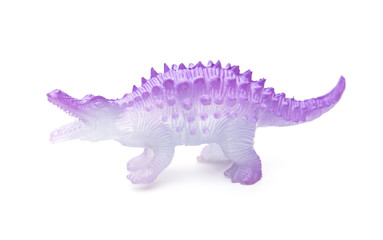side view purple plastic dinosaur toy on a white background