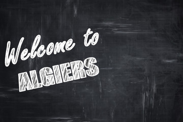Chalkboard background with chalk letters: Welcome to algiers