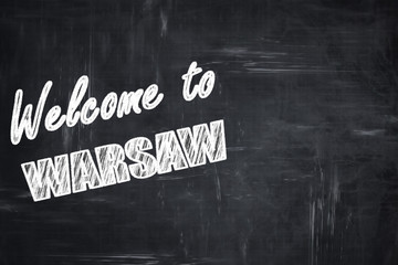 Chalkboard background with chalk letters: Welcome to warsaw