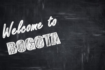 Chalkboard background with chalk letters: Welcome to bogota