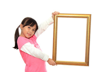 Happy little girl holding a blank picture frame on white backgro
