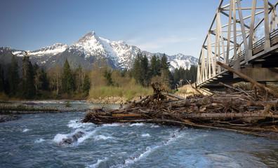Logs jam up under the bridge on the Sauk River