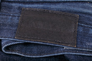 blue jeans with black leather tag
