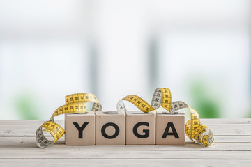 Yoga sign with measure tape
