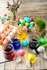 Coloring eggs in bright colors for Easter holiday