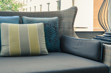 Outdoor deck with pillows on sofa