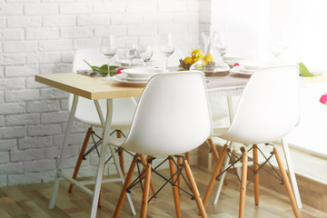 Table served with white dishes.