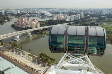 empty cabin of Ferris wheel at a height above Singapore